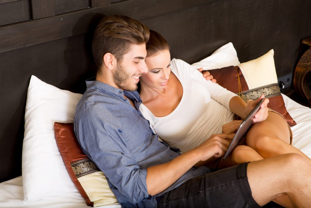 Young couple using a Tablet PC hotel room
